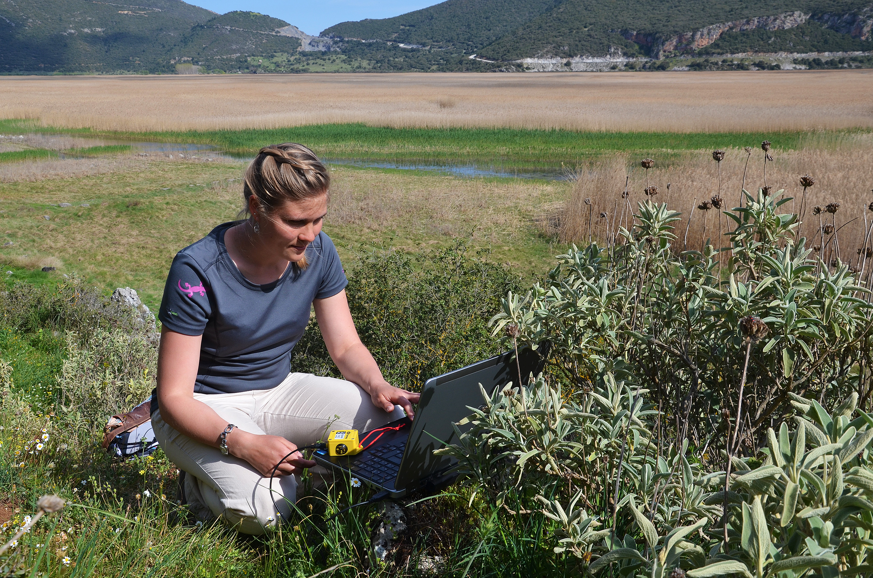 PhD student Joana Seguin collects climate data from a data logger at Lake Stymphalia