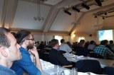 Sascha Krüger Marco Zanon listening a presentation